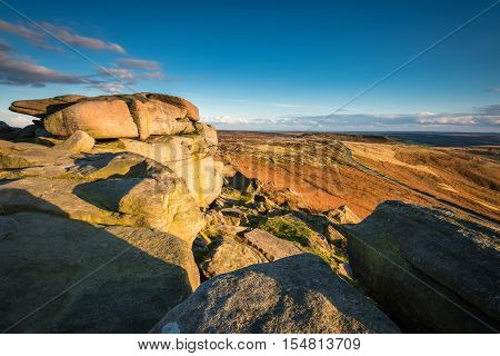 View from Stanage Edge, which is located in the Peak District National Park in England. Stanage Edge is the largest of the gritstone edges that overlook Hathersage in Derbyshire