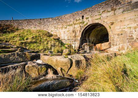 Upper Burbage Bridge West, above Burbage Brook which flows under it, in the Peak District National Park