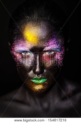 art photo of beautiful model woman with creative plastic unusual black mask bright colorful makeup with black face