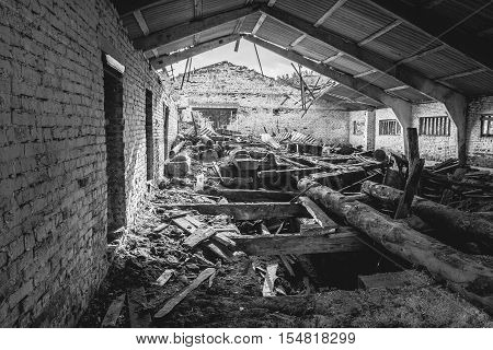 Black and white - abandoned lumber mill, the dirt, dust and the old board, wide angle