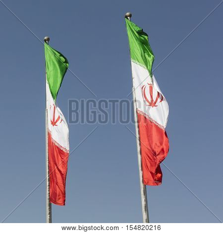 Iran flags against blue sky in Teheran