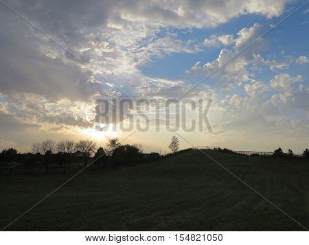 Sun trying to break thru cloud formation in Hoffman Estates, Illinois