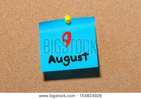 August 9th. Day 9 of month, color sticker calendar on notice board. Summer time. Empty space for text.