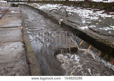 Urban stream in winter. The Lybid river in Kyiv.