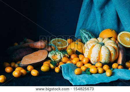 Fall Harvest on the Dark Wooden Table Beautiful Autumn Background using for Wallpaper or for Card with Free Space for Text