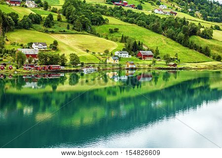 Norway. Small town and cruise port Olden in Norwegian fjords. Tourist camping