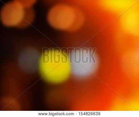 abstract colored light spots background blur orange yellow