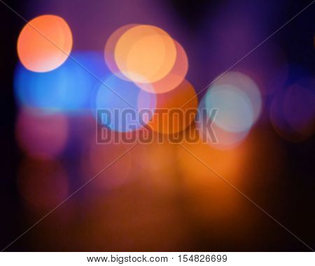 abstract colored light spots background blur orange