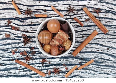 Thai Recipes : Stewed boiled egg with tofu and streaky pork ,call Khai Palo in Thai, take photo with herbs as Chinese star anise ,cinnamon,black pepper,cilantro roots and stems