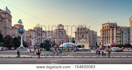 Kiev, Ukraine - September 11, 2016: Panorama view of Maidan Nezalezhnosti Independence Square at weekend in Kiev. People walking through square passing cafes restaurants and shops