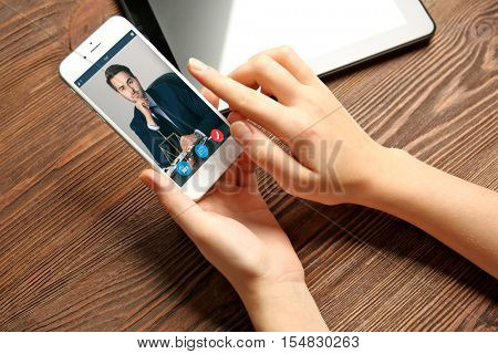 Woman video conferencing with lawyer on smartphone. Video call and online service concept.