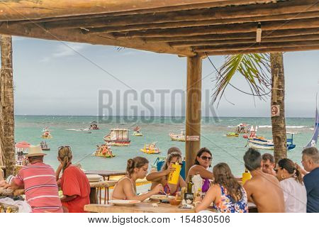 PORTO GALINHAS, BRAZIL, JANUARY - 2016 - Crowded restaurant in front of beach in Porto Galinhas a watering place located in Pernambuco Brazil