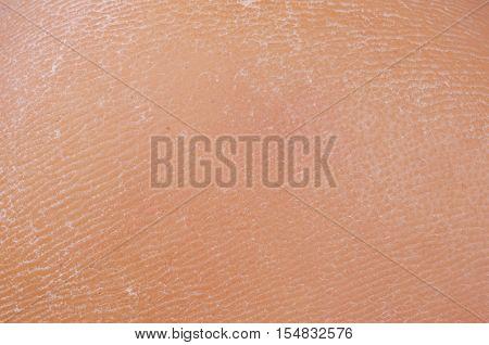 Man leg skin on a heel. Abstract
