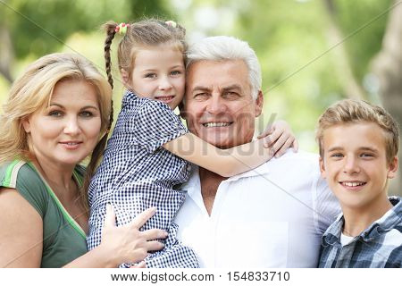 Grandparents with grandchildren in park