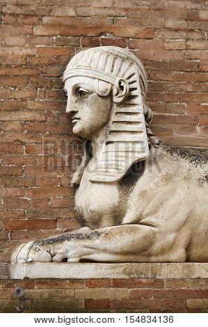 Sphinx statue in a renaissance building in Urbino, Italy