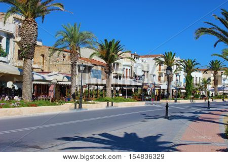 City street with palm trees in the Greek town of Rethymnon