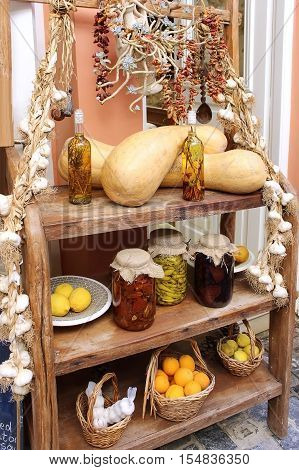 Homemade canned goods garlic bundles fruits and vegetables stand on a shelf