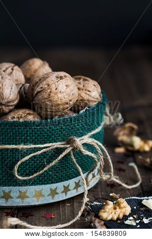 Walnuts in a Festive Christmas Tin on Rustic Table