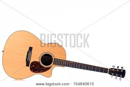 A traditional acoustic, steel string guitar .