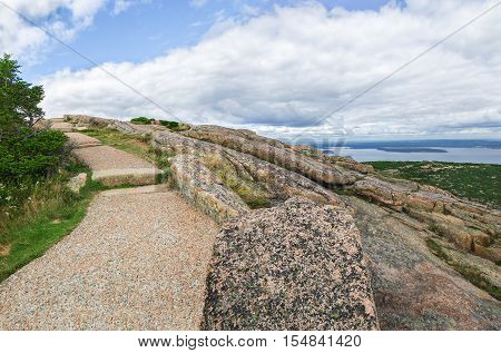 Park Walk:  A paved walkway curves along the side of Cadillac Mountain in Acadia National Park.