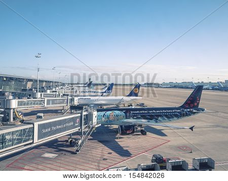 Brussels, Belgium - November 2, 2016: The view from a terminal window at Brussels international Airport Zaventem over airplanes from different airlines standing at the gates.