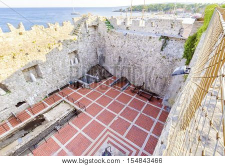 The interior of the Frankopan Castle at Kamplin square in Krk Croatia - Frankopanski Kastel part of the medieval city walls. View of the courtroom ancient excavations catapult and sea port of the island.