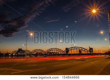 Night panoramic scene in Riga Latvia at river Daugava