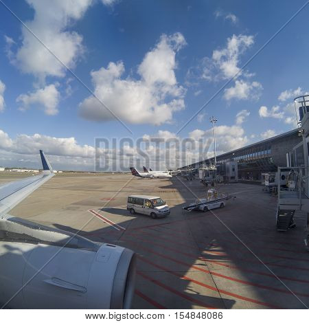 Brussels, Belgium - November 2, 2016: The view from an airplane window at Brussels international Airport Zaventem over airplanes standing at the gates.