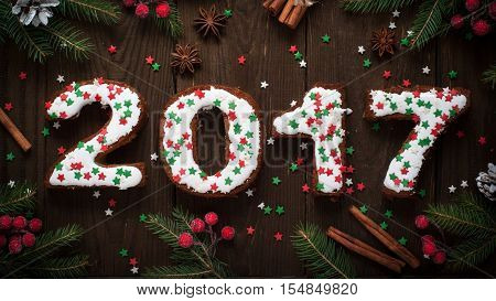 Festive New Year baking. sweet pastry letters 2017 and decorations. Christmas dessert food.