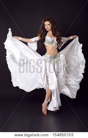 Beautiful Arabian Bellydancer Sexy Woman In Bellydance Colorful Costume Isolated On Black Background
