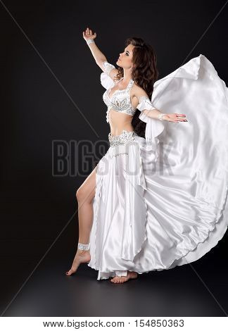 Beautiful Arabian Bellydancer Sexy Woman In Bellydance White Costume Over Black Studio Background. S