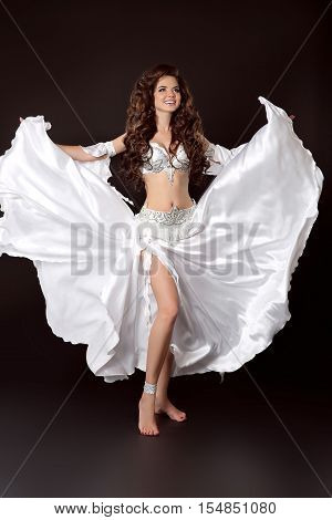 Beautiful Arabian Bellydancer Sexy Woman In Bellydance White Costume Isolated On Black Background. S