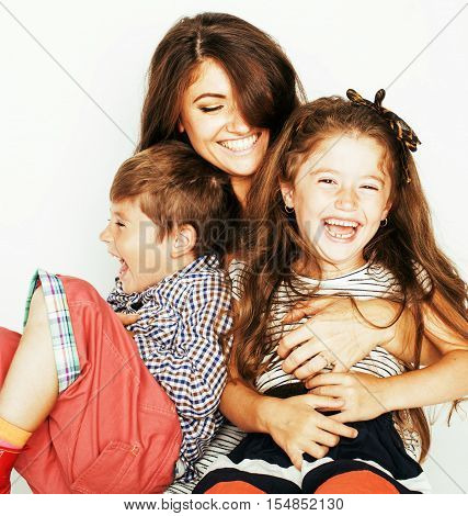 young mother with two children on white, happy smiling family inside, lifestyle people concept close up