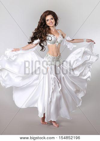 Gorgeous Arabian Woman Bellydancer Isolated On Studio Background, Sexy Oriental Brunette Girl Dancer