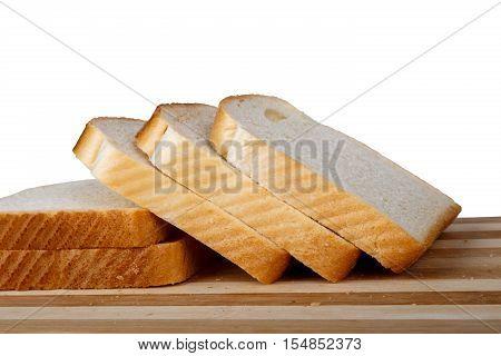 Slices Of Toast Bread On Breadboard
