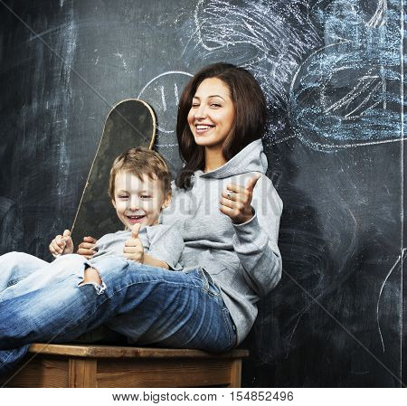 young hipster teenage girl sitting with her brother in classroom multinational, lifestyle people concept close up