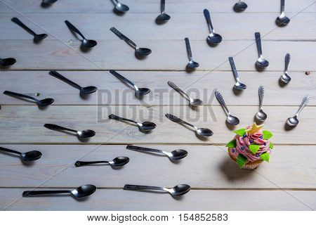 Witchhunt by teaspoon on a muffin on old wooden table