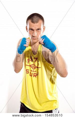 Muscular kickbox or muay thai fighter punching, isolated on white background. Ukrainian fighter. Ukraine. Blue.Yellow.