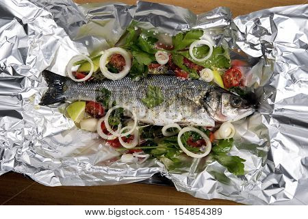 fresh seabass in parcel ready to baked