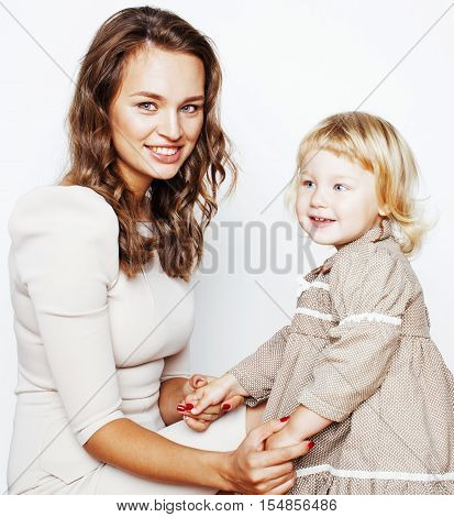 young pretty stylish mother with little cute daughter hugging, happy smiling family, lifestyle people concept close up