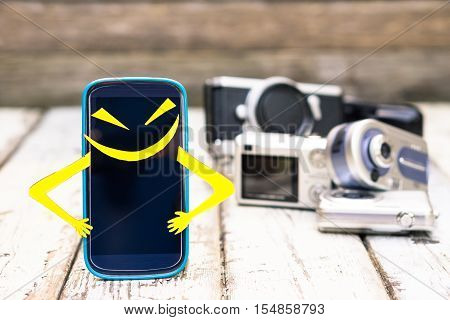 New mobile smart phone superhero with funny expression of pride standing on wood with old cameras background - Telephone vs entry level cameras - Marketing and sales concept of photography devices