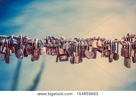 Love Lock on the Large Metal Chain Closeup Photo. Padlocks Locked Fixture Symbolizing Love