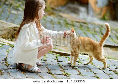 Adorable Little Girl And A Cat