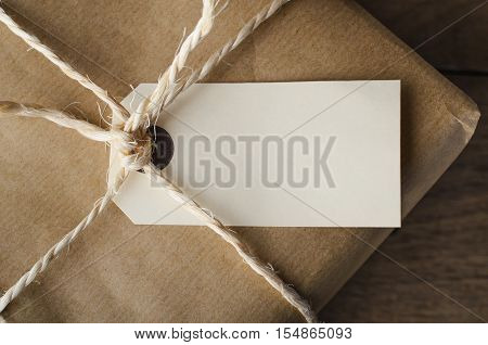 Close Up Of Blank Tag On String Tied Parcel