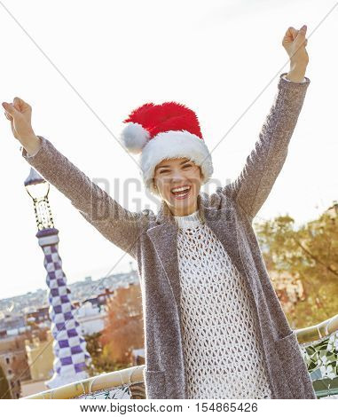 Smiling Womanin Santa Hat At Guell Park In Barcelona Rejoicing