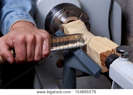 the piece of wood is making on a lathe