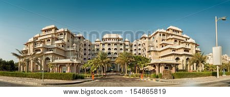 DUBAI, UAE - OCTOBER 11, 2016: The entrance to the Grandeur Residences on Palm Jumeirah Crescent.  The Palm Jumeirah is an artificially built island on the coast of the UAE