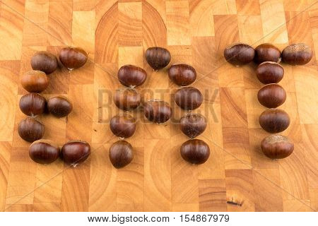 Spanish Chestnuts On A Wooden Plate Formed To The Word