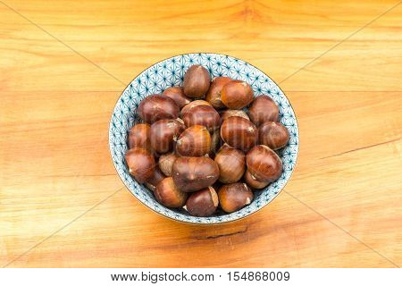 Spanish Chestnuts In A Vintage Dish On Wooden Plate Background