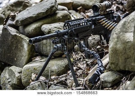 United states army ranger machine gunner in the forest